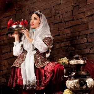 Serving Pomegranate at Mehregan in Persian/ Iranian National Costume -- Photo source: FriendlyIran.com