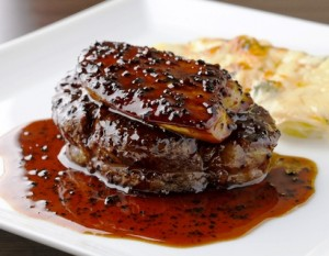 Filet mignon topped with foie gras in truffle sauce